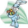 Easter rabbit holding coloured eggs