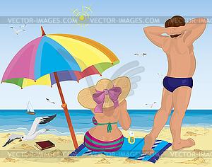 Ehepaar am Strand unter dem Sonnenschirm - Vector Clip Art