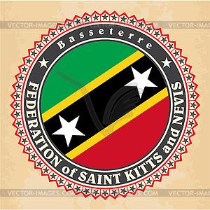 Vintage-Label-Karten von St. Kitts und Nevis-Flagge - farbige Vektorgrafik