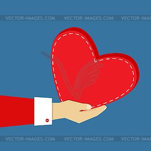 Hand mit einem Herz - Stock Vektor-Bild