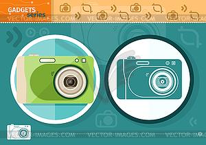 Digitalkamera in Rahmen auf grünem Hintergrund - vektorisiertes Clipart